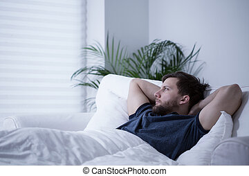 Suffering from insomnia - Man suffering from insomnia after...