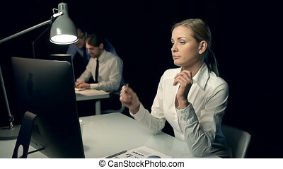 Suffering from Overwork - Close up of female office worker...