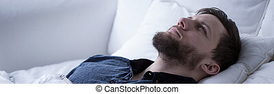 Suffering from sleeplessness - Man suffering from...