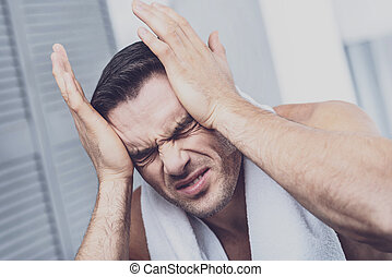 Suffering man feeling severe headache