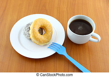 Sugar and chocolate donut on breaking time.