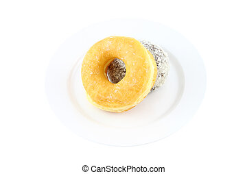 Sugar and chocolate donut on dish on white background.