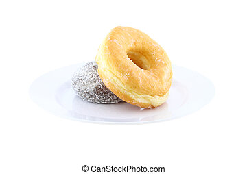Sugar and chocolate donut side view on dish on white background.