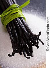 Sugar and vanilla beans - Sugar on a chalkboard and whole...