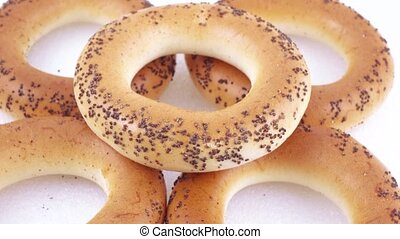 Sugar bagels with poppy seeds - A stack of bakery products....