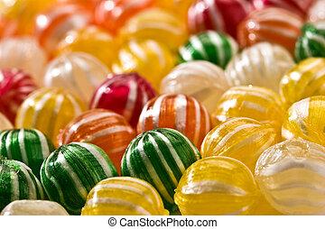 sugar candy - food serias: sweet background of striped sugar...