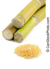Sugar cane and brown sugar over white background