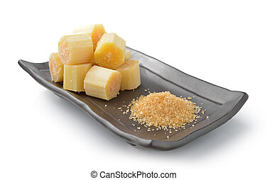 sugar cane on black plate