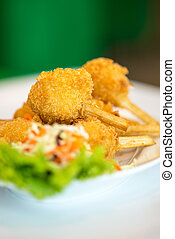 Sugar cane skewered fried minced shrimps or Chao tom -...