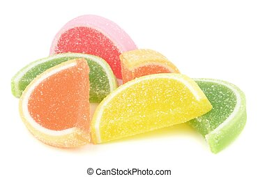 A pile of sugar coated fruit jelly sweets on a white background