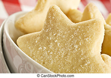 Sugar coated shortbread cookies in star shapes stacked up - ...