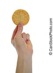 Sugar Cookie - Hand holding sugar snickerdoodle cookie on...