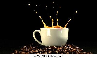 Sugar cube falling in coffee cup an
