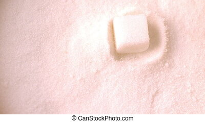 Sugar cube falling into pile - Sugar cube falling into pile...