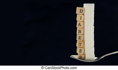 Sugar cubes and diabetes dice vanishing from teaspoon with...