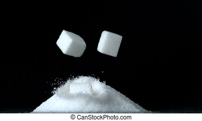 Sugar cubes falling down into pile