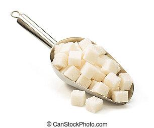 sugar cubes in scoop on white - sugar cubes in scoop...