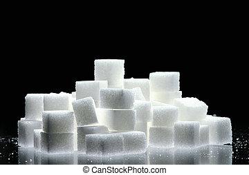 sugar cubes on black