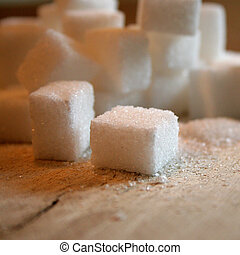 sugar cubes - many white sugar cubes on a table