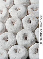 sugar donuts - rows of mini sugar doughnuts