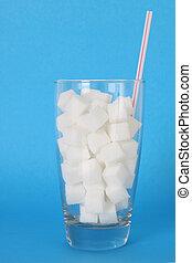 Sugar drink - Glass filled with sugar cubes. Toxic sugar...
