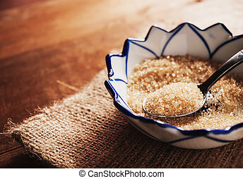 Sugar in a stainless spoon in still life tone