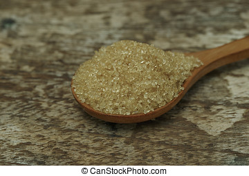 Sugar in wooden spoons