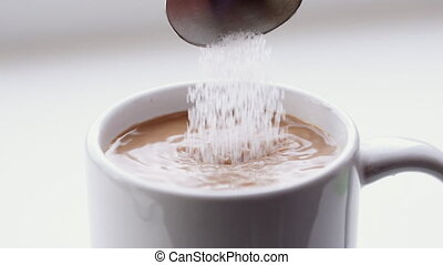 Sugar poured into coffee