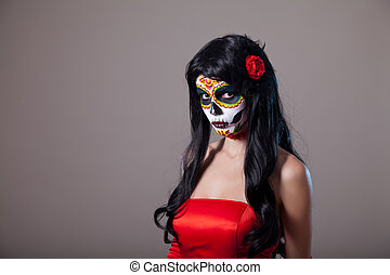 Sugar skull girl in red dress, studio shot