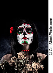Sugar skull girl with dead roses, studio shot over black ...