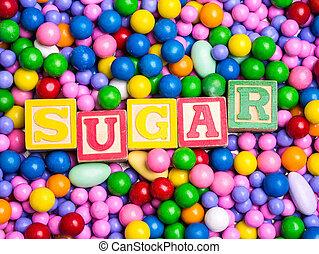 Sugar spelled out in alphabet block
