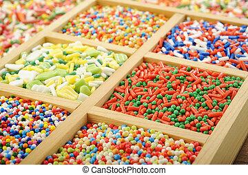 sugar spreading pastry and rainbow sprinkles