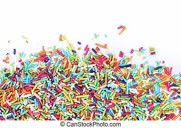Sugar sprinkles - Colorful sugar sprinkles on a white...