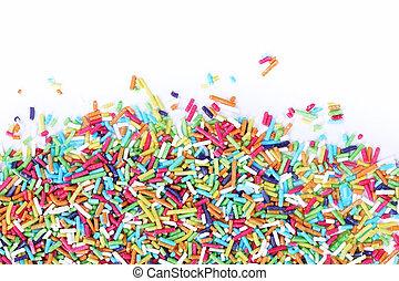 Sugar sprinkles - Colorful sugar sprinkles on a white ...