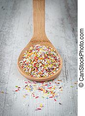 Sugar sprinkles - Colorful sugar sprinkles on a wooden spoon
