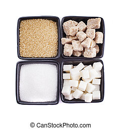 Sugar types in black bowls isolated on white