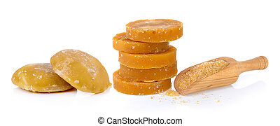 Sugarcane Hard Molasses or Jaggery and sugar in scoop