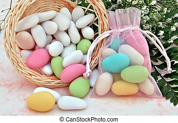 Sugared colors in a basket with flowers in the background