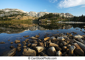 Sugarloaf Mountain and Medicine Bow Peak reflected in Libby Lake in Medicine Bow National Forest in Wyoming.