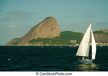 Sugarloaf mountain in Rio de Janeiro - Sailboat in front of...