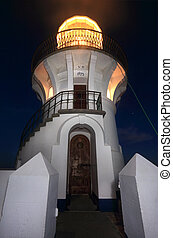 Sugarloaf Point Lighthouse at night, located at Seal Rocks...