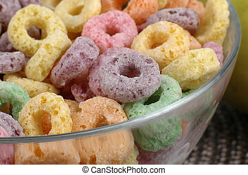 Colourful sugary cereal viewed close-up in a bowl.