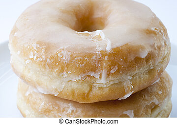 Fresh donuts with sugar and white background