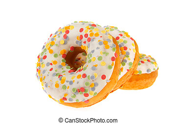 Three sugary donuts with colorful glaze isolated over white background