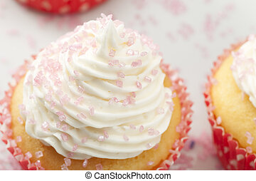 Sugary Frosting - Top of yellow cupcake topped with white...