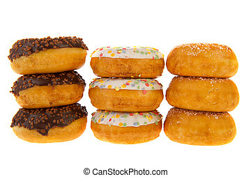Three sugary sweet donuts with glaze isolated over white background