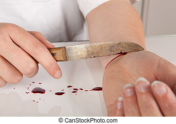Suicide attempt of a hand cutting a wrist with a knife