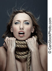 Suicide - Suffering woman in crisis with terrible rope on...