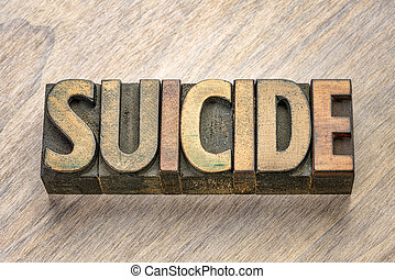 suicide word in letterpress wood type
