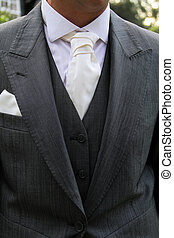 suit and tie - close up image of person wearing a suite...